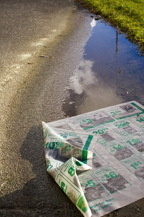 Newspaper in the puddle