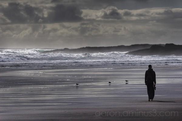 Walking alone on Karekare beach