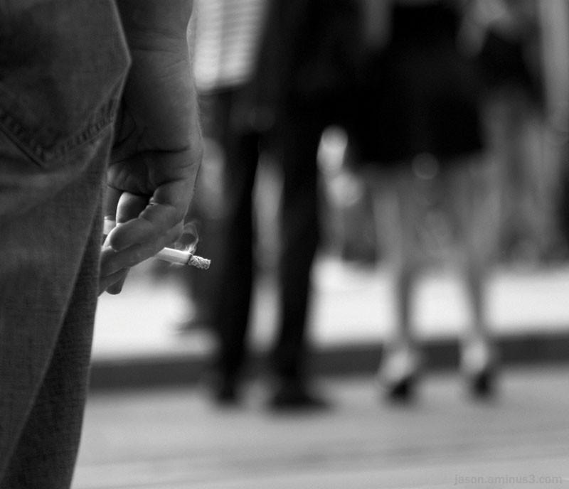 street portrait cigarette legs