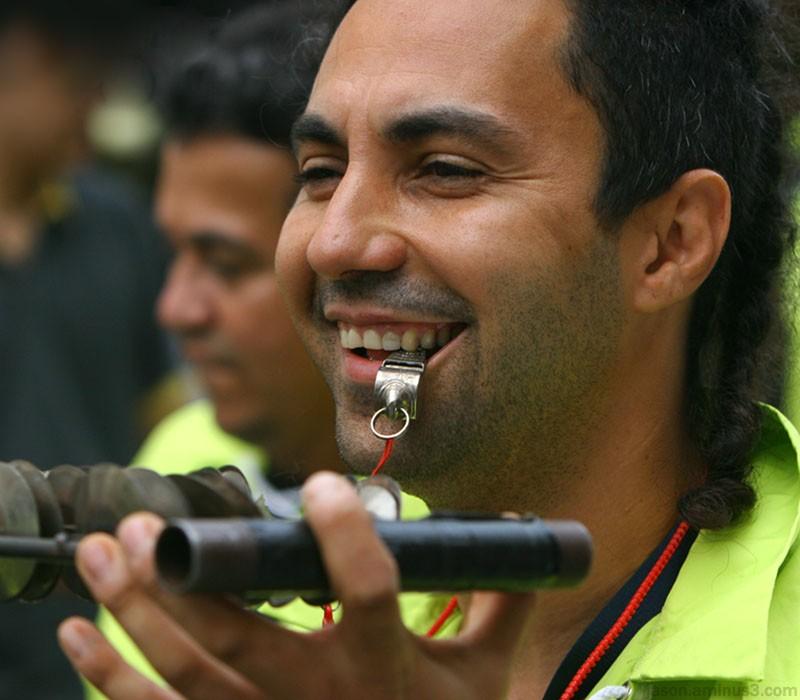 man percussion whistle smile