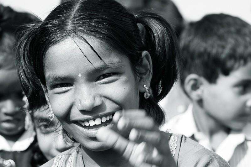 School girl smiling or shying