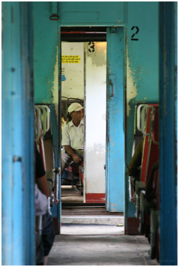 a man in the 3rd class in a train in Sri Lanka