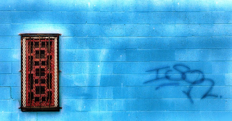 Blue wall and window.