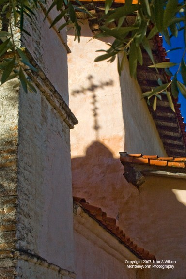 Shadow of Cross Atop Steeple on Wall of Mission
