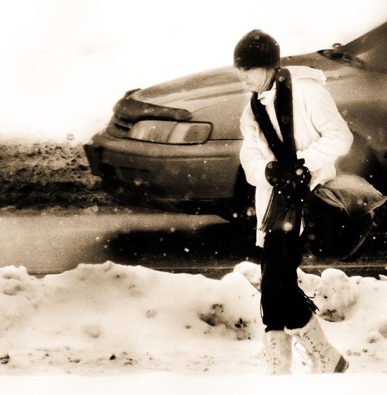 Shot of Person Walking Through Snow