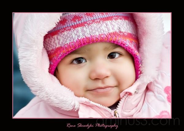 Cute Girl in Pink Snowsuit
