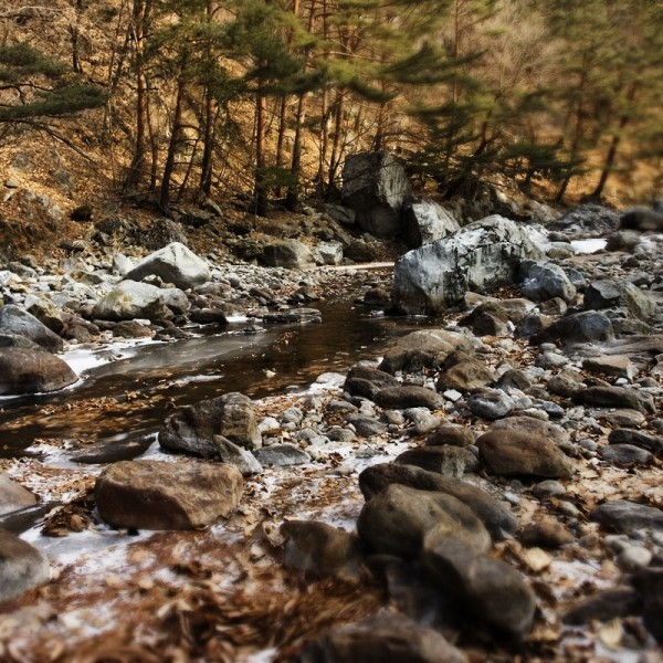 Winter hike along a stream in the mountains, Korea