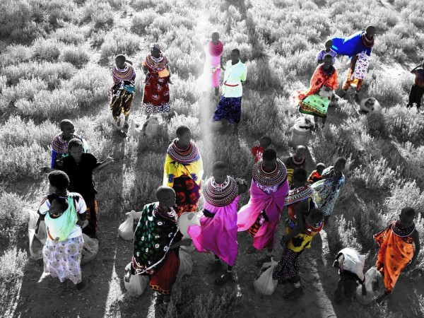 A group of women receive relief food in Kenya.
