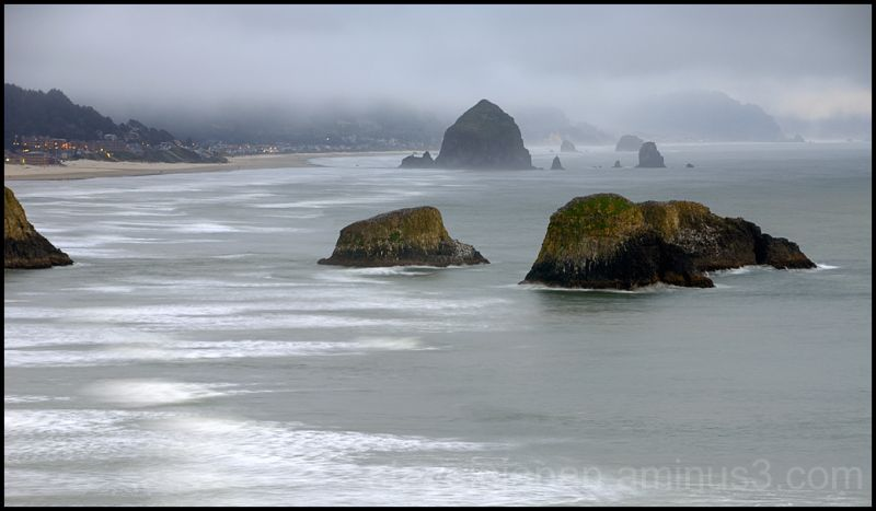 Dusk descends on the Oregon coast as fog thickens.