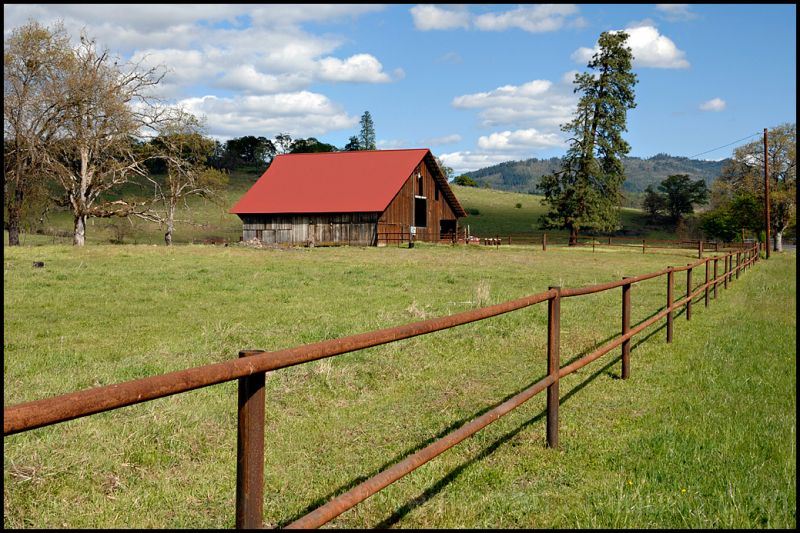 A red roofed barn in Jackson County, Oregon, USA.