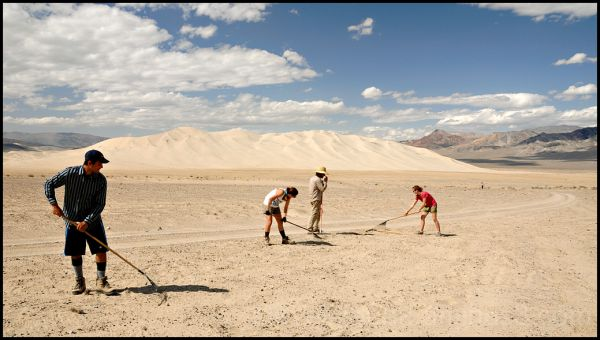 Students raking at Eureka Dunes in Death Valley.