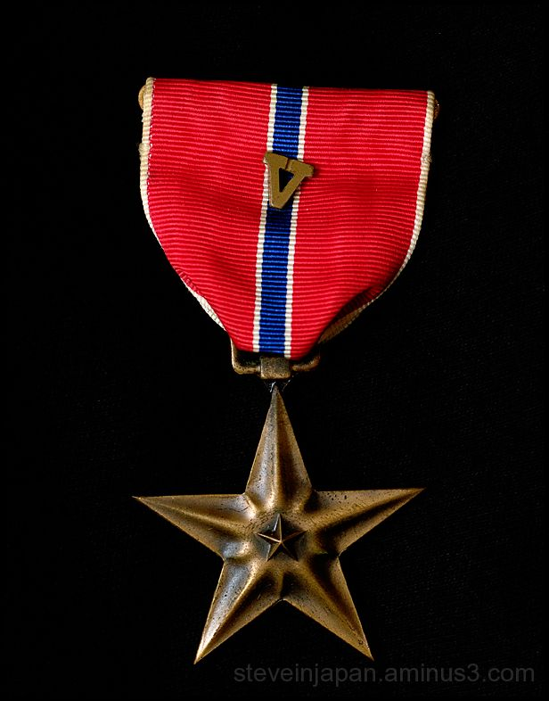 The Bronze Star Medal with Valor device.
