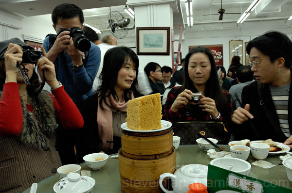 A lady waiting to dig in at Lin Hueng Tea House.