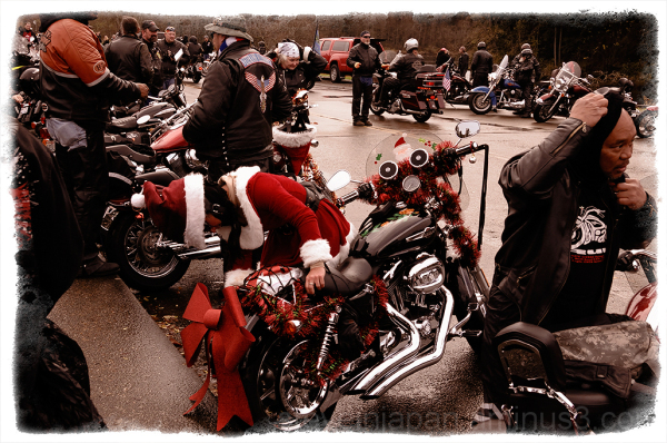 A festive rider and bike at the Olympia Toy Run.