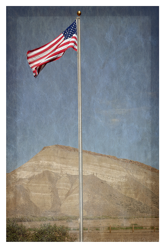 The US flag flies over the Painted Hills, Oregon.