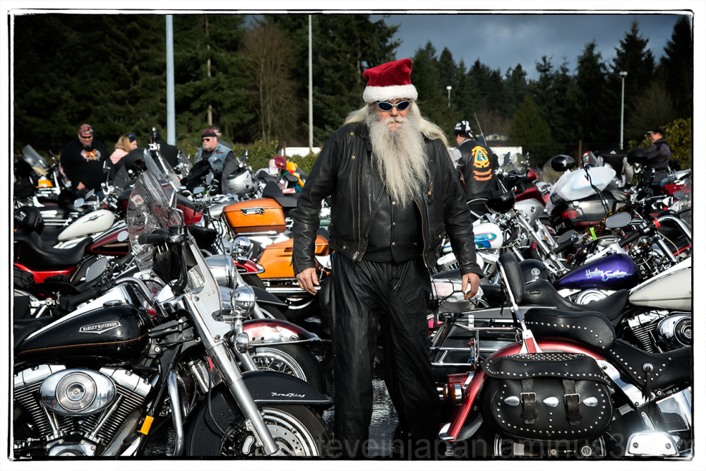 A Santa biker arriving at the Olympia Toy Run.