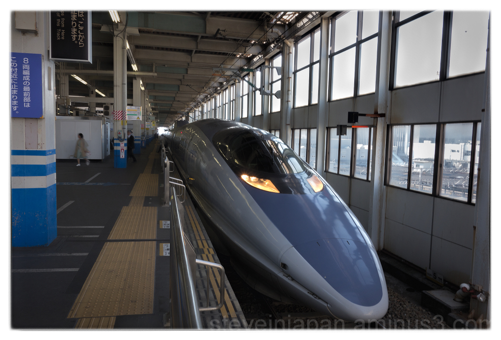 A Shinkansen arrives at Hiroshima Station.