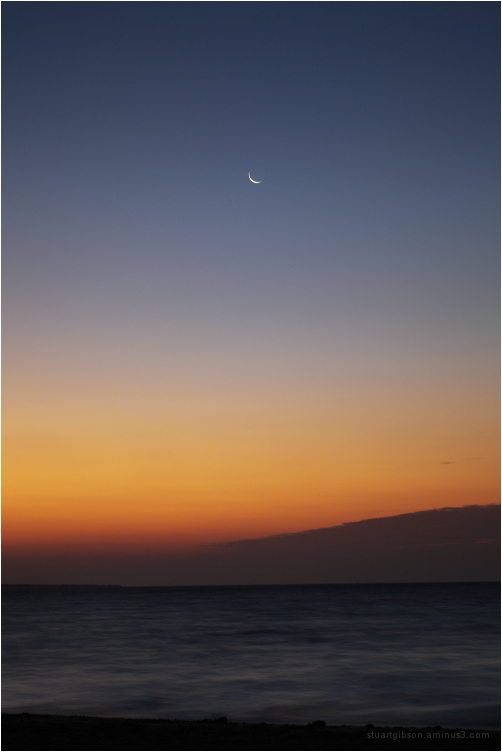crescent moon at sunrise