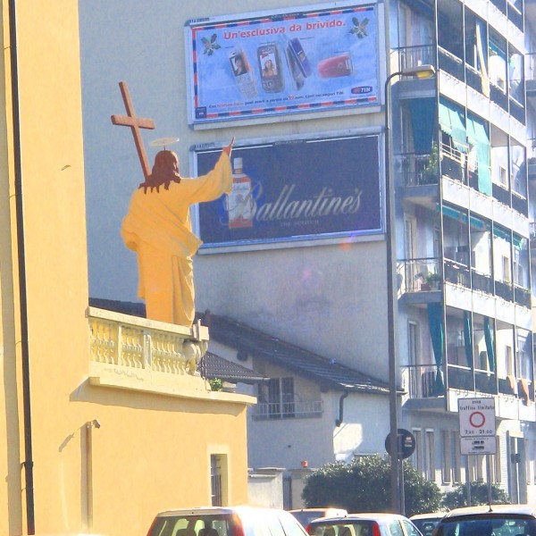 Statue of Jesus waves to billboard
