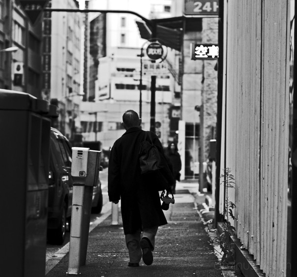 man carrying camera, tokyo, john cleary