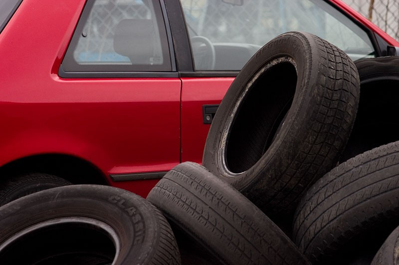 Tires and red car