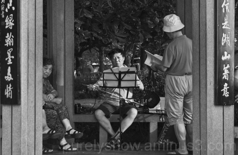 musician playing at West Lake Hangzhou