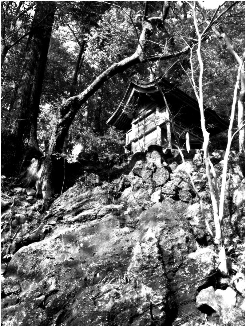 Small temple building at top of rocky cliff