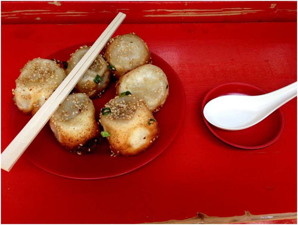 Chinese fried dumplings on red background