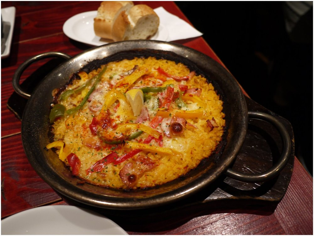 Cast iron dish of paella in restaurant