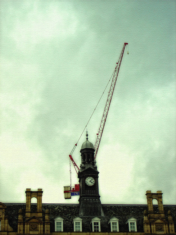 a crane superimposed with landmark building leeds