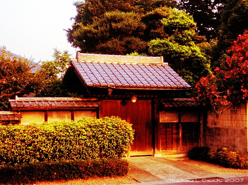 Traditional wooden entrance gate to Japanese home