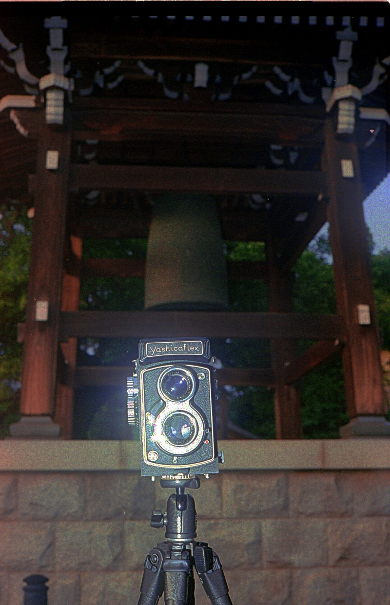 Yashicaflex A2 in front of temple bell, Japan
