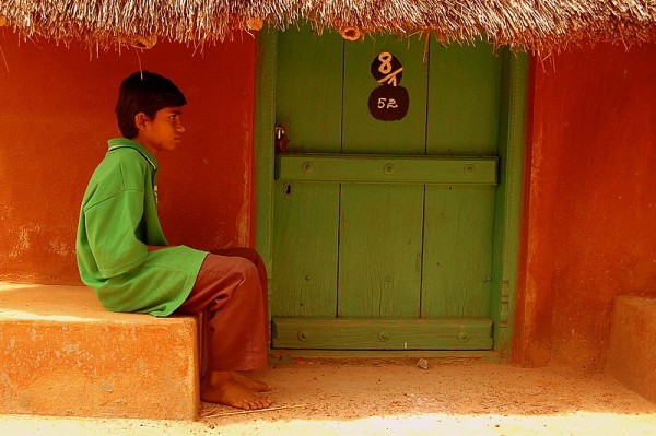 Boy outside the locked door...