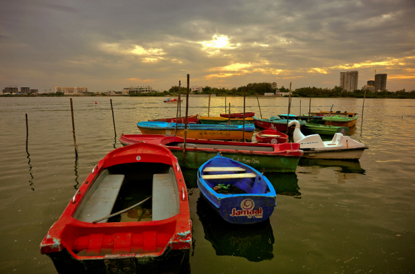 Boats rest as the sun is about set in Muttukad