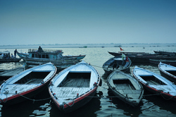 Boats lay rest on the banks of Ganges