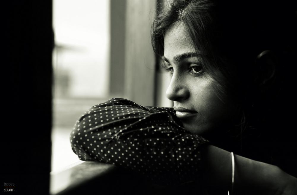 Girl by the window side