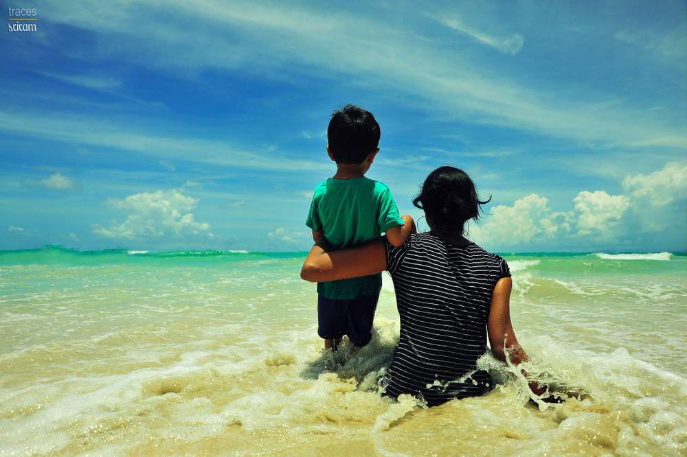 Mumma, boy and the beach