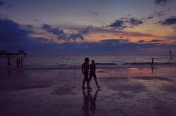Conversations over the wet sand walk