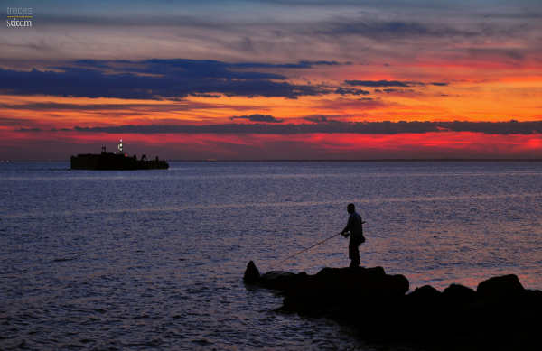 Sight of the lone fisherman at twilight