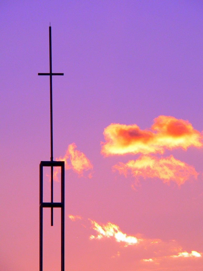Christian cross at sunset