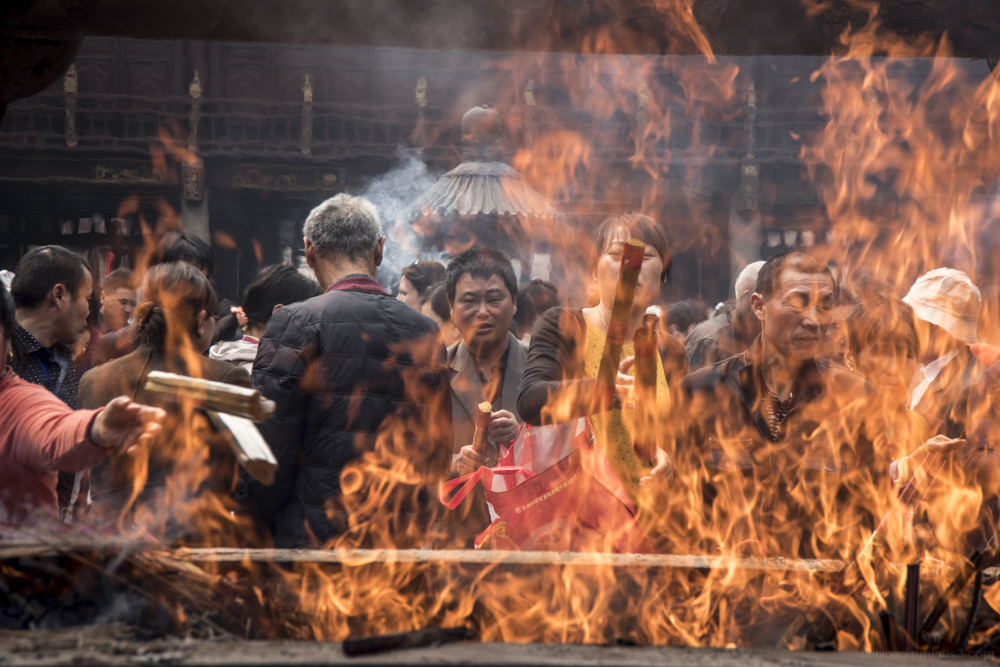 People making offerings at Buddhist temple