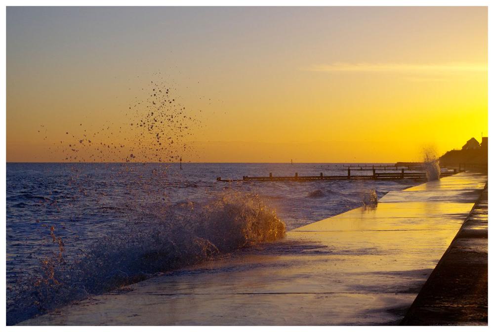 sunrise splashes waves golden dawn light norfolk