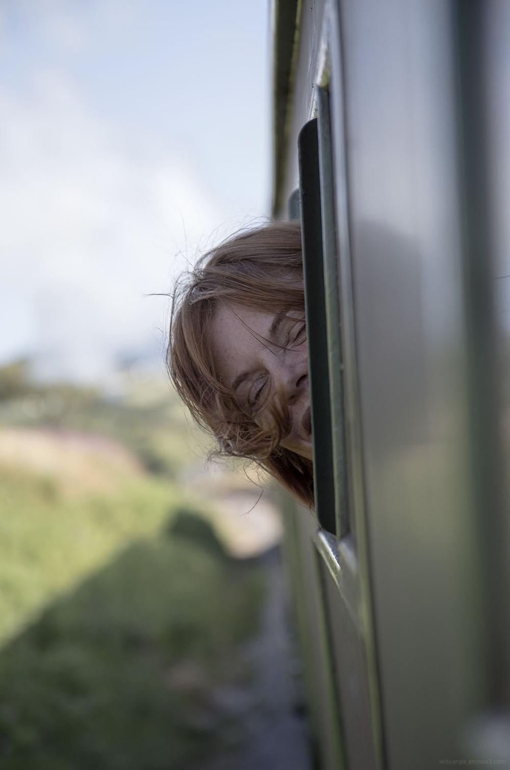 steam train dorset smiling hair blowing woman
