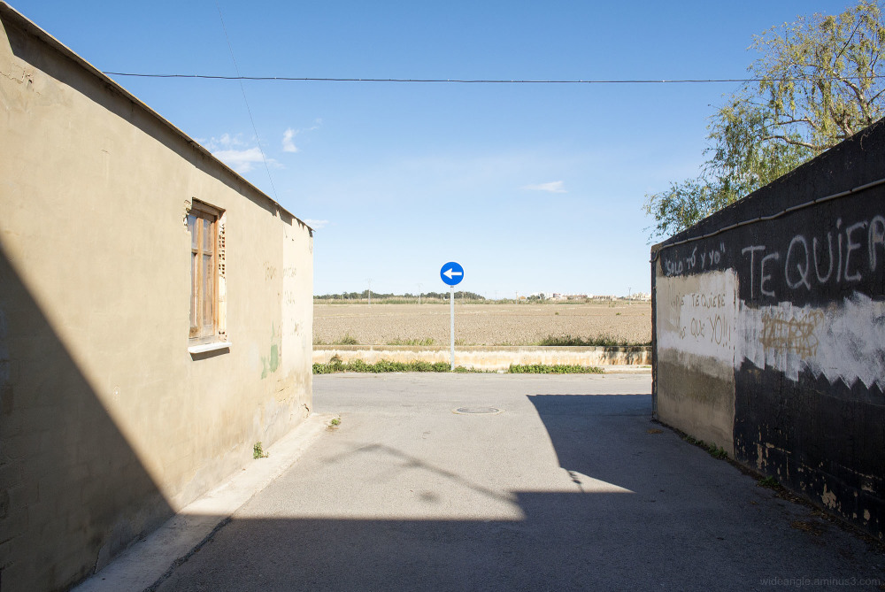 one way blue signs road village spain
