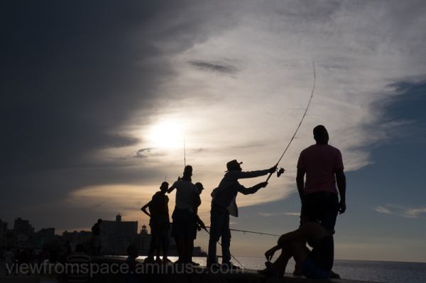 fishing el malecon havana cuba summer time