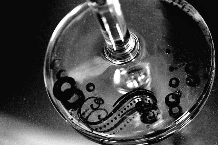 black and white shot of painting on glass
