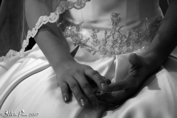 black and white photo of bride's hands