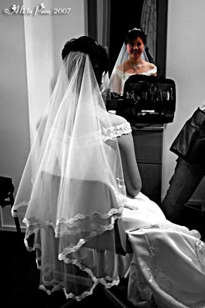 bride looking at mirror, selective desaturation
