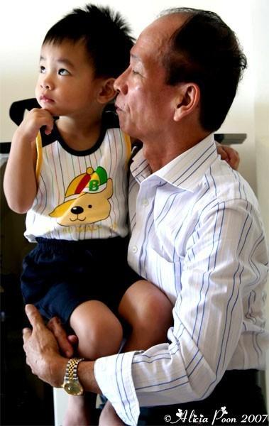 grandfather holding his grandchild lovingly