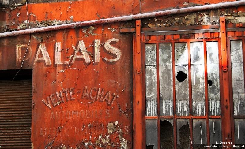 Old garage advertisment in Lyon, France